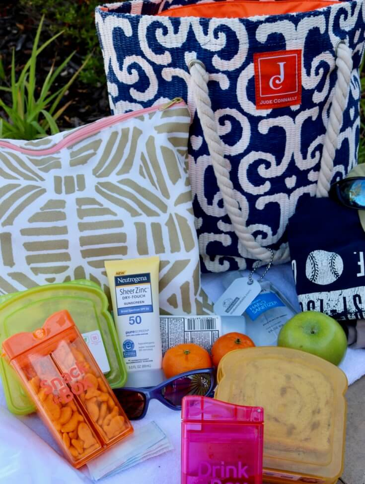10 Helpful Outdoor Playdate Essentials for Moms and Kids with waterproof bag and containers for snacks