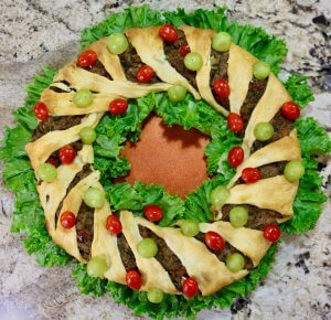 An edible Christmas Wreath - Easy Vegetarian Crescent Ring Recipe and Party Appetizer - perfect for entertaining