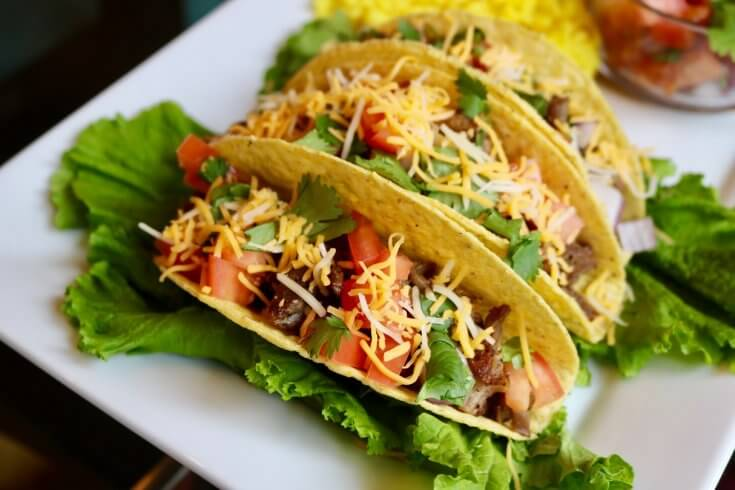 Enjoy with shredded cheese - Grilled Carnitas Tacos Recipe