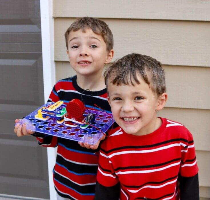 Boys love creating with SNAP Circuits - FREE STEM Science Activity Pack - Learn Science and Save Lives