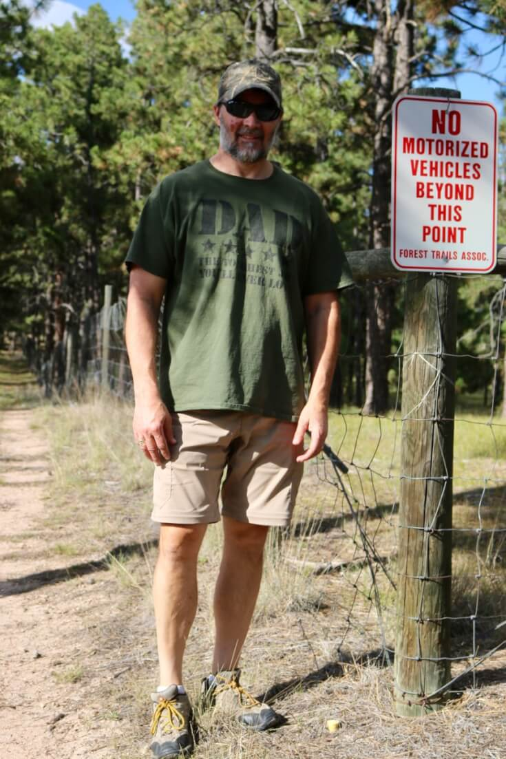 My husband by the hiking trail near our home